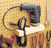 Drill holster on a pegboard rack