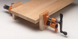 Wood spacers for pipe clamps